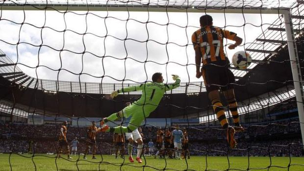 Hull City's goalkeeper Allan McGregor and Ahmed Elmohamady defend a free kick.