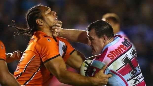Paul Gallen offers a don't argue to Martin Taupau.
