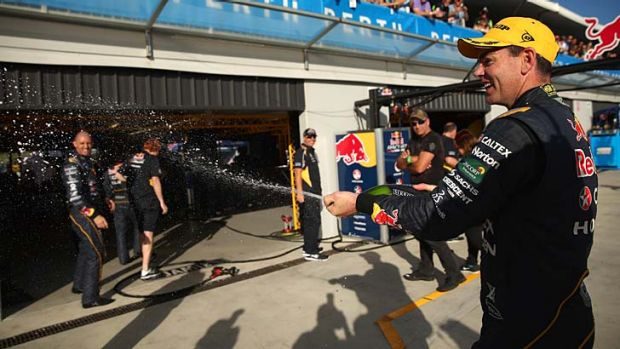 Craig Lowndes celebrates after his win on Saturday.