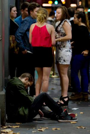 Party-goers outside one of the many licensed premises on King Street.