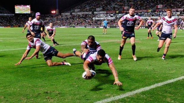 Cowboys winger Matthew Wright touches down against the Roosters.