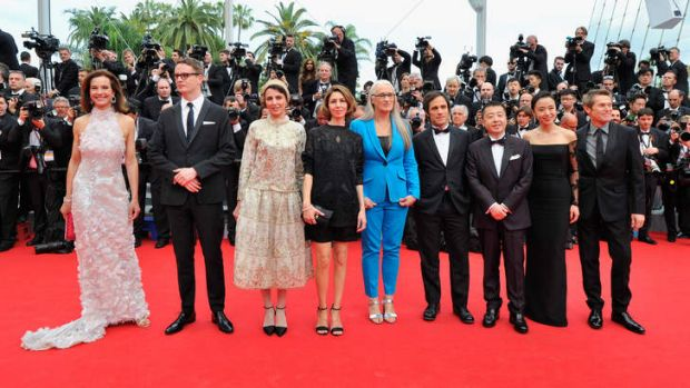 In balance: Cannes jury members strut on the red carpet.
