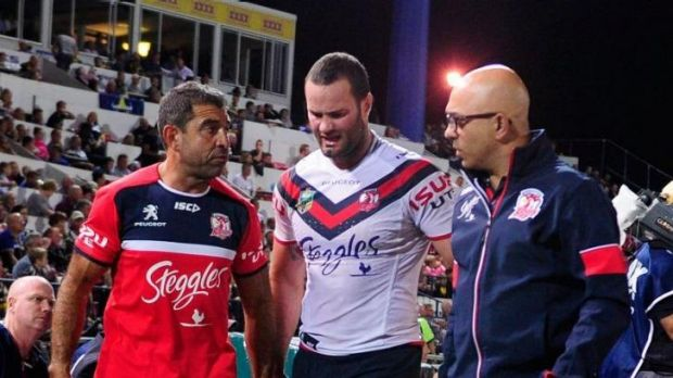 Setback: Roosters back-rower Boyd Cordner battles the pain of a high ankle sprain as he leaves the field on Saturday night.