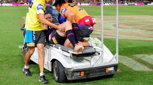 Cowboys forward Gavin Cooper is taken from the field against the Roosters.