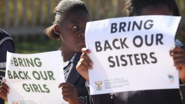 Students from a South African school hold posters to support the release of the kidnapped girls in Nigeria.