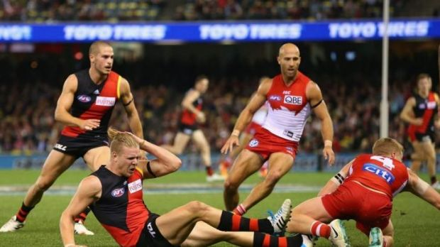 Occupational hazard: Michael Hurley nurses his head after colliding with Dan Hannebery on Friday night.