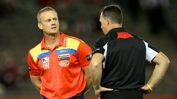 Rival coaches Guy McKenna of the Suns and Alan Richardson of the Saints have a chat before Sunday's game.