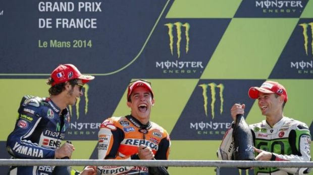 Marc Marquez of Spain (centre - winner), Valentino Rossi of Italy (left - second), and Alvaro Bautista of Spain (third) ...