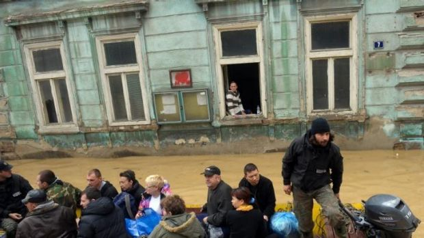 A group is evacuated over flooded streets in the Serbian town of Obrenovac.