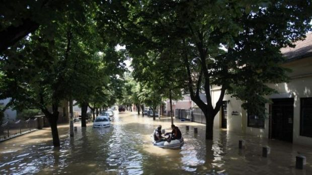 Residents escape on a boat in the flooded town of Obrenovac.