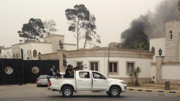 Smoke rises near the parliament building in Libya.
