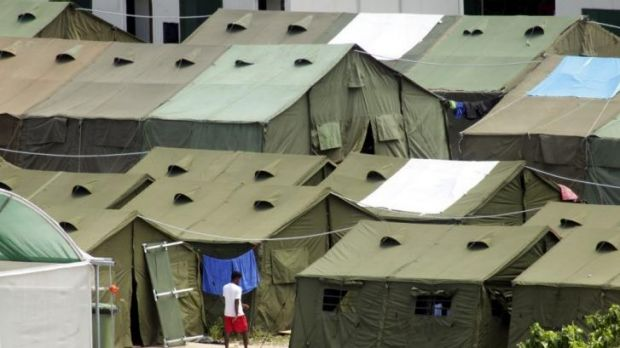 A refugee wanders through the tents at the Nauru detention centre.