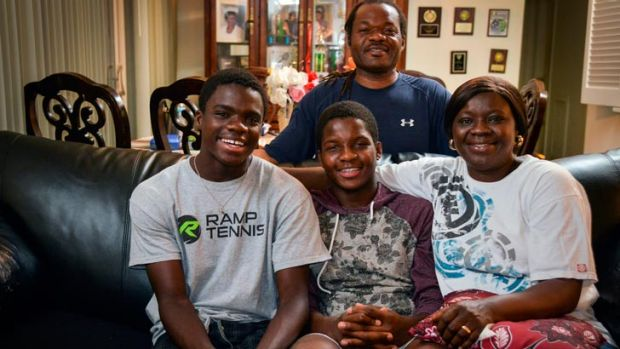 Clockwise from top, the Tiafoe family. Francis Sr., Alphina, Franklin and Francis at their apartment.
