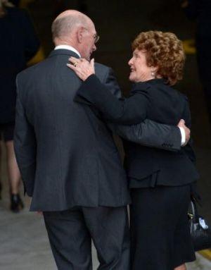 Kevin Bartlett comforts Maureen Hafey.