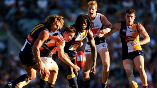 Nic Naitanui, seen here contesting possession with Toby Greene of GWS, says that the Eagles now have the confidence to ...