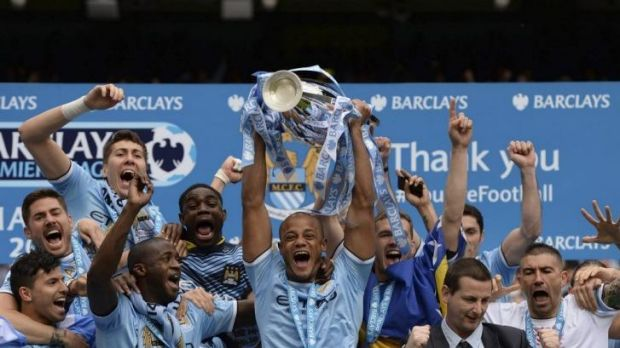 Manchester City's captain Vincent Kompany celebrates after winning the English Premier League title.