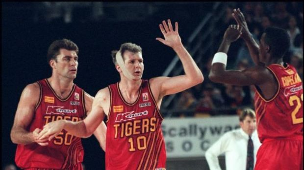Mark Bradtke, Andrew Gaze and Lanard Copeland celebrate a basket during the mid-1990s