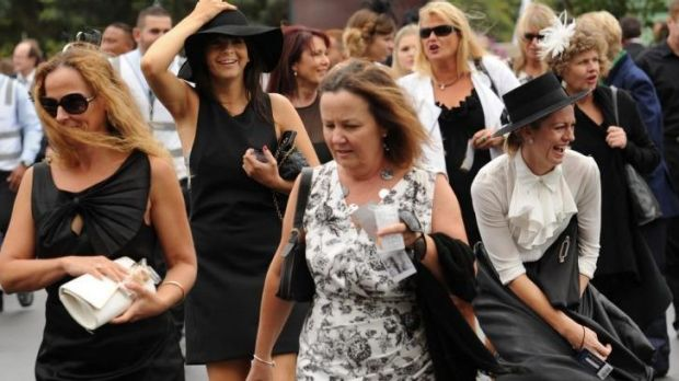 Crowds arrive in the wet and windy conditions during day one of The Championships at Royal Randwick in April.