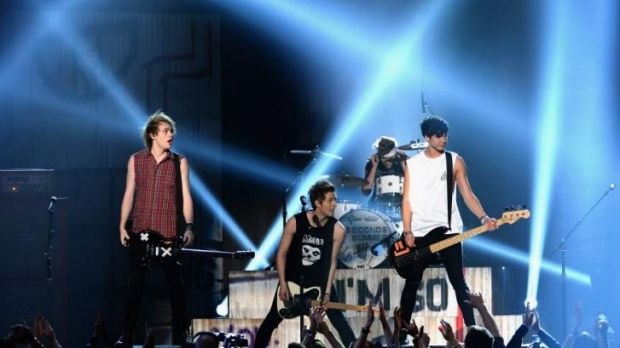 Red hot: Sydney band 5 Seconds of Summer perform at the Billboard Awards.