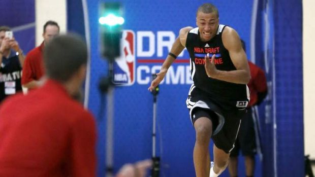 Dante Exum participates in the three-quarters-court sprint in the 2014 NBA basketball draft combine last Friday.