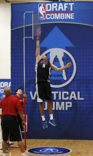 Dante Exum leaps in the vertical jump in the 2014 NBA basketball draft combine in Chicago.