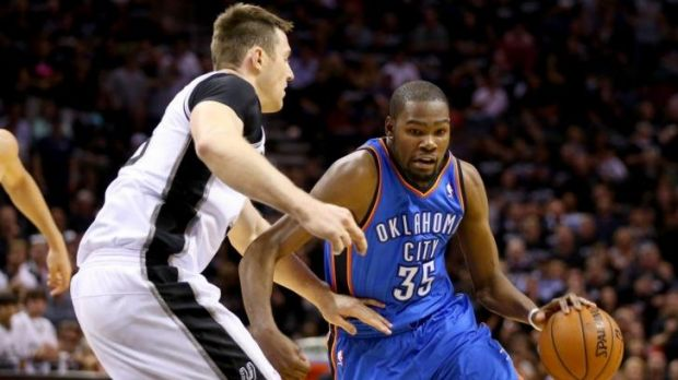 Australian Aron Baynes tries to stop Oklahoma's Kevin Durant during game one of the Western Conference finals.