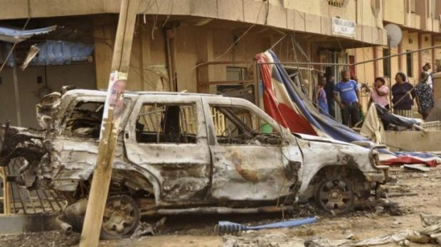 A car destroyed by an explosion that killed four people in a Christian neighbourhood of Kano on Monday. Boko Haram is ...