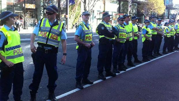 Police stand guard at Broadway during the student protest.