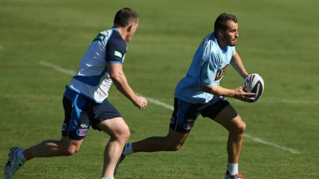 Blues five-eighth Josh Reynolds tries to evade Paul Gallen at training on Wednesday in Coffs Harbour.
