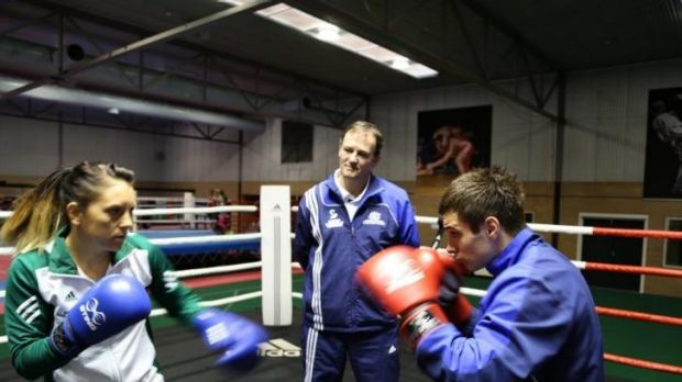 Kevin Smith watches Shelley Watts and Andrew Moloney train.