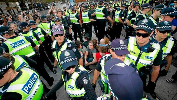 Police prepare to remove a  group of student protesters staging a sit-in at the intersection of Spring and Bourke ...