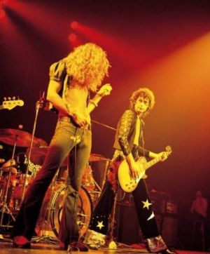 Jimmy Page on guitar and Robert Plant on vocals perform in Led Zeppelin during filming in 1973 of <i>The Song Remains ...