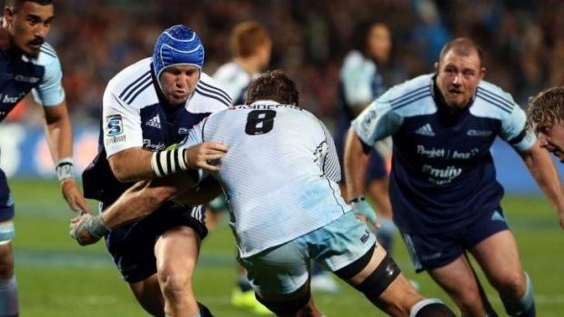 James Parsons looks to bust through the tackle of Willem Alberts.