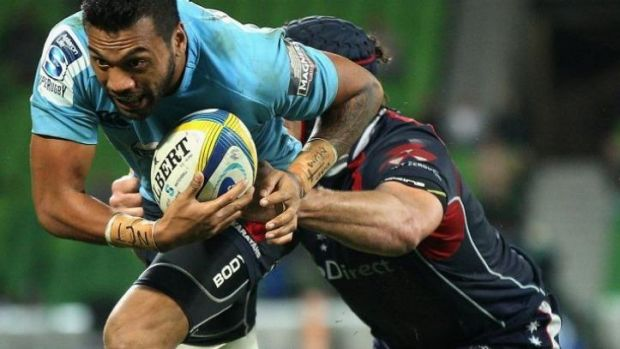 Alofa Alofa of the Waratahs is tackled by Cadeyrn Neville of the Rebels
