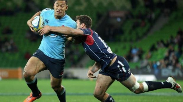 Israel Folau of the Waratahs breaks a tackle on his way to scoring.