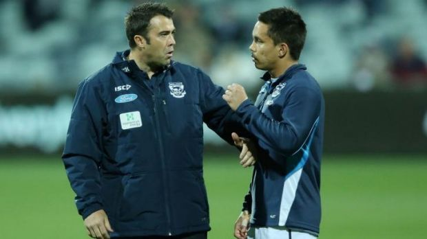 Geelong coach Chris Scott has a word with Mathew Stokes during the game.