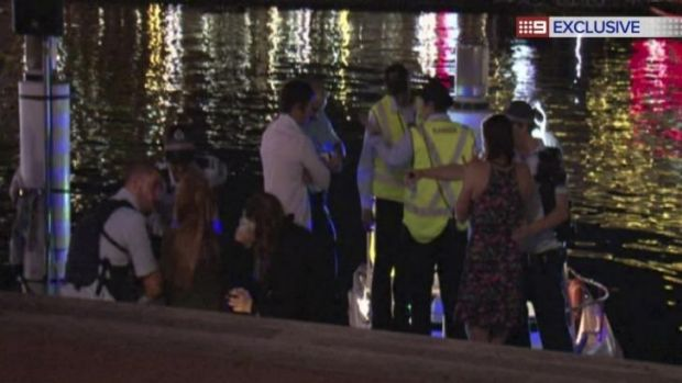 Tragedy: Police talk to potential witnesses at the scene.