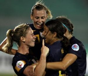 Elise Kellond-Knight (left) celebrates with her teammates after scoring the winning goal against South Korea in the ...