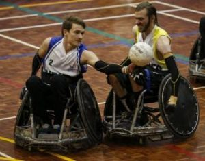 Canberra's Daniel Savage (right) takes on Simon Bartlett in wheelchair rugby on Saturday.