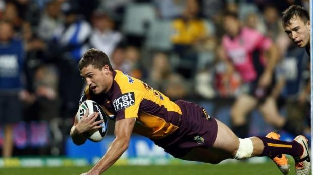 Broncos winger Corey Oates diver over to score against Wests.