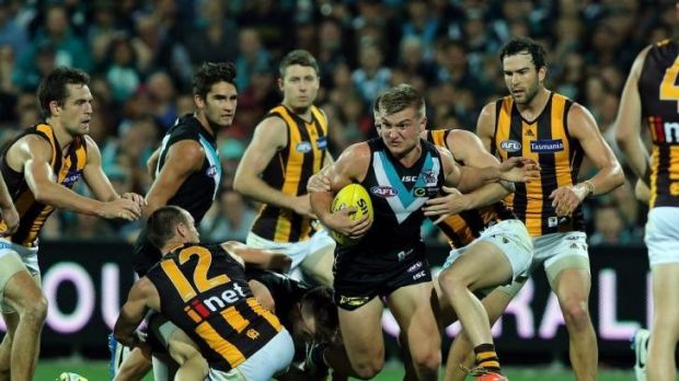 Coming through: Port Adelaide's Ollie Wines bursts clear during the win over Hawthorn on Saturday night.