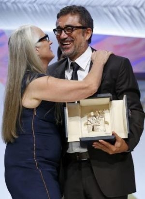 Cannes jury president Jane Campion kisses director Nuri Bilge Ceylan, Palme d'Or award winner for his film 'Winter Sleep'.