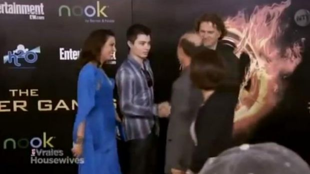 Elliot Rodger with his parents on the <i>Hunger Games</i> red carpet.
