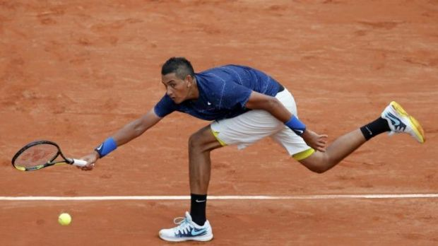 Nick Kyrgios stretches for a forehand return against Milos Raonic.