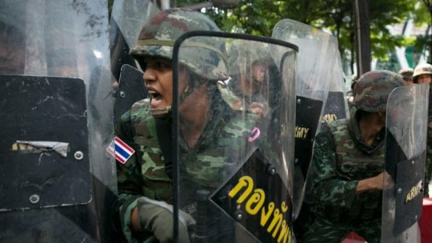 Thai military on the defensive during an anti-coup protest.