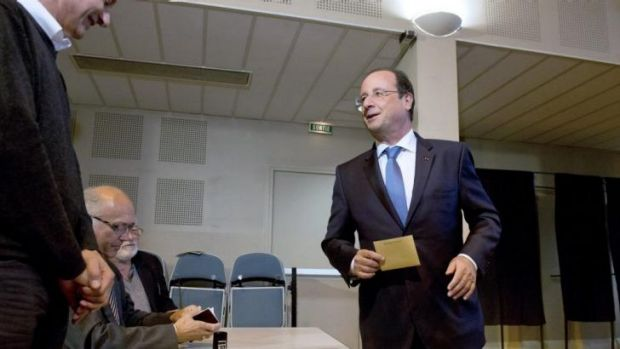 French President Francois Hollande casts his vote at a polling station in Tulle, central France.