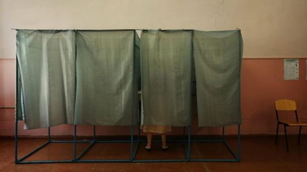 A woman votes in the Ukrainian Presidential election in Mariupol, East Ukraine.