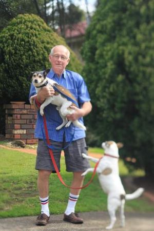 Home with the dogs: Roger Rogerson at his house in Padstow Heights in 2011.