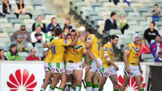 Raiders centre Paul Vaughan celebrates with his team after a try, in their win against the North Queensland Cowboys.