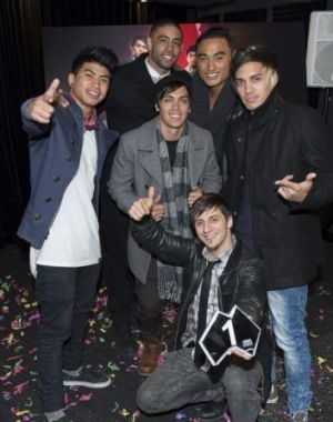 Justice Crew receiving their award for their ARIA singles chart number one.
